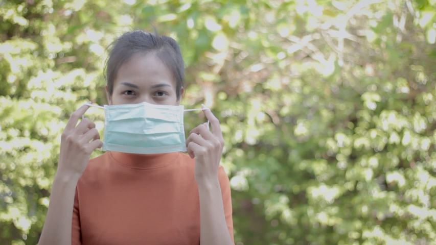 Footage young asian people wear masks to prevent disease Covid-19. Concept video. Commercial video.   Shutterstock HD Video #1047946249