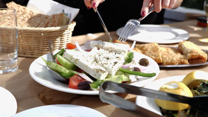 Greek salad and saganaki in Taverna   Shutterstock HD Video #1048032439