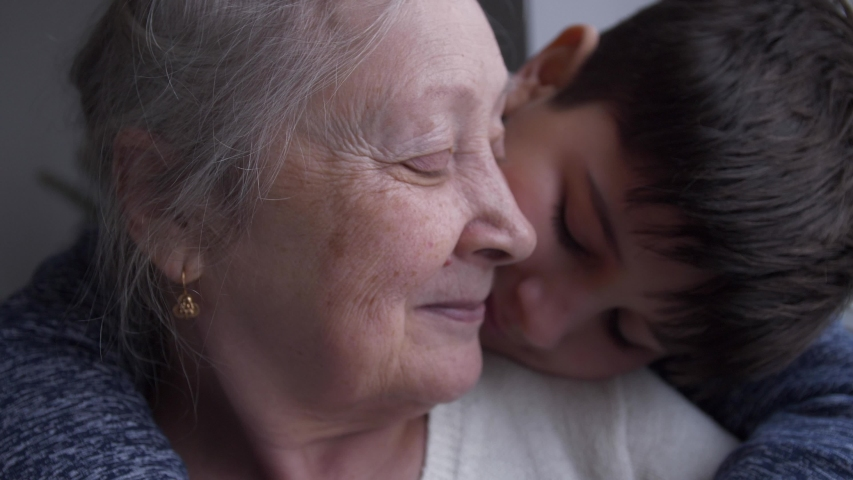 Baby hugs and kisses his grandmother Royalty-Free Stock Footage #1048044424