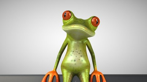 Fun green frogs next to a laptop