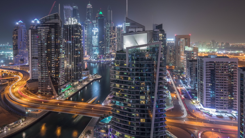 Aerial view of Dubai Marina residential and office skyscrapers with waterfront during all night timelapse with blinking lights turning off. Floating boats and yachts | Shutterstock HD Video #1048048591