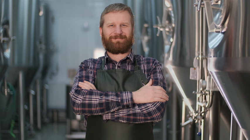 One Barkeeper, Modern Technology, Germany Machinery, Distiller Sample, Bavaria Lab, Checking Laboratory. Portrait of a proud businessman brewer during beer production Royalty-Free Stock Footage #1048050310