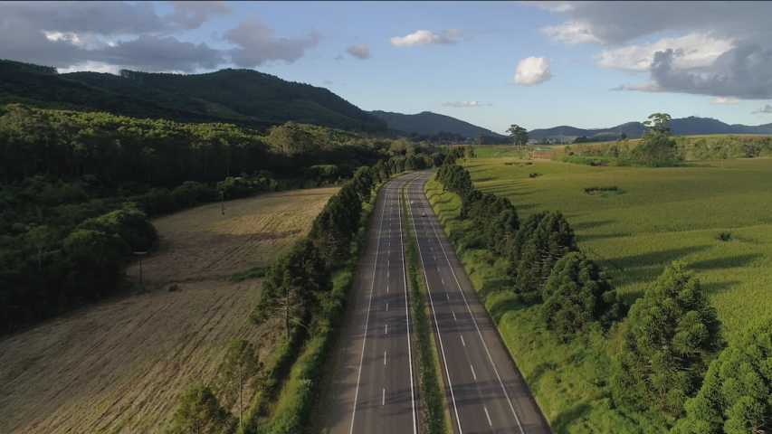 Aerial View of a Landscape Empty Highway, Zoom Out, Sun Light | Shutterstock HD Video #1048075714