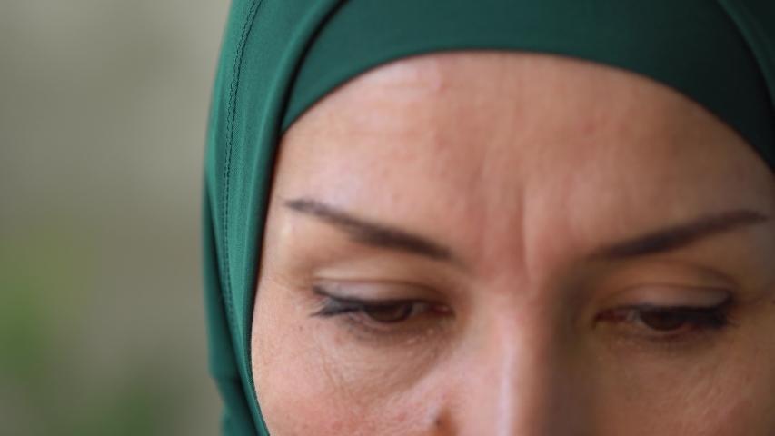 Lebanon, Beirut. Lebanese Sad Muslim woman 's eyes close up. anti-racism