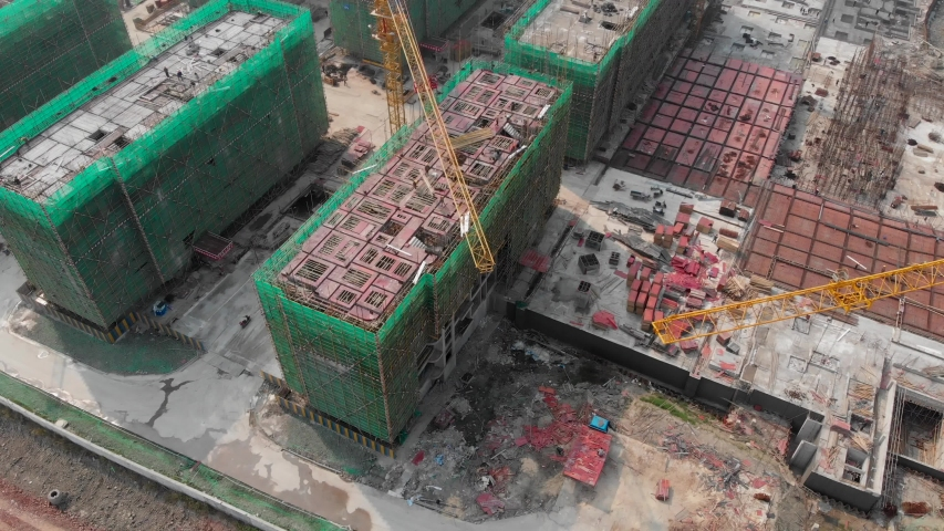 Aerial view from the drone of a construction site with cranes in China #1048101793