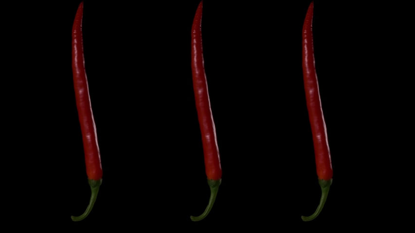 Three pods of red hot pepper rotate on a black background. | Shutterstock HD Video #1048103761