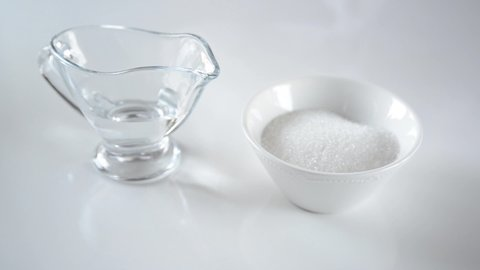 Almond flour, sugar and water on white table. Chef takes ingredients for making french macarons. Cooking macaroon. Steps cooking baking macaroon and confectionery.