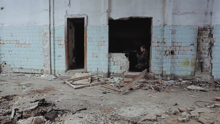 The capture team moves through an old destroyed building. Fight against terrorists.