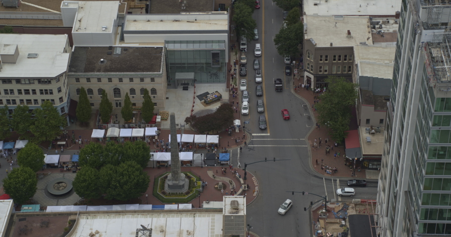 Asheville North Carolina Aerial v17 Panning birdseye looking over downtown market scene rotating to tower construction view - July 2019 | Shutterstock HD Video #1048158685