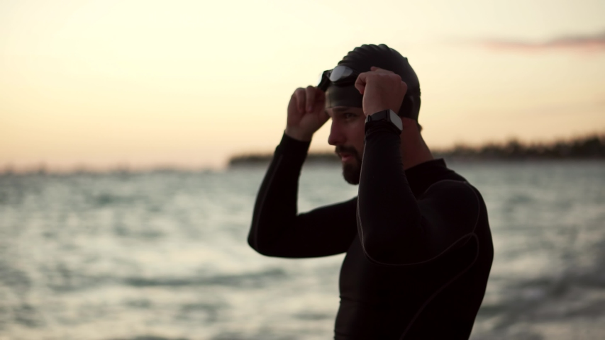 Swimmer Silhouette Training Triathlon In Open Water.Swimmer Stretching Exercise In Ocean.Professional Triathlete Prepare Swimming Workout Sport Recreation.Triathlete Ready Triathlon Competition Swim Royalty-Free Stock Footage #1048163101