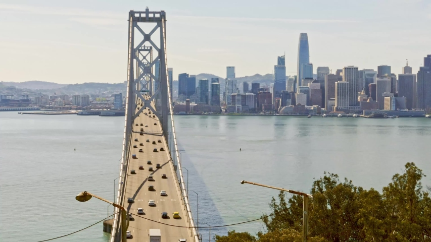 Bay suspension Bridge San Francisco sunday traffic midday sunny february timelapse bay area downtown copy space