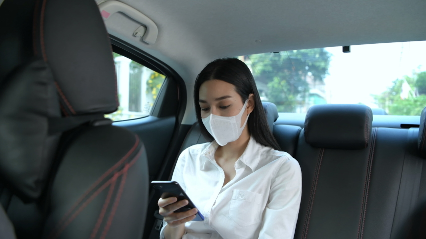 Travel Concept. The masked woman is traveling to the doctor at the hospital. 4k Resolution. | Shutterstock HD Video #1048169503