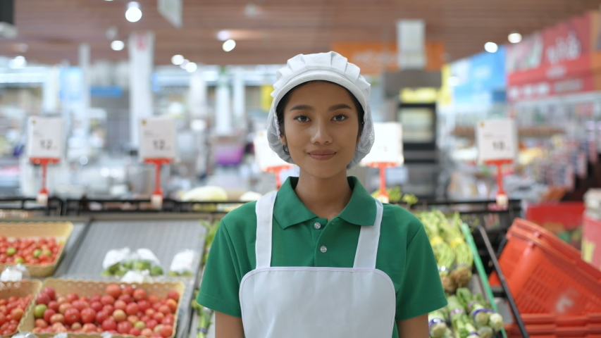 Shopping concepts. The sales staff are confident in customer service at the fruit and vegetable department. 4k Resolution. Royalty-Free Stock Footage #1048169683