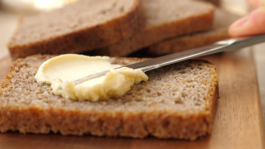 Spreading Vegan Butter On Rye Bread Without Dairy And Eggs. Closeup.