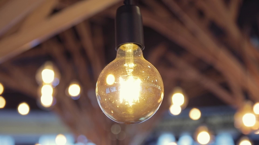 Wooden ceil roof with vintage incandescent bulbs close up | Shutterstock HD Video #1048189579