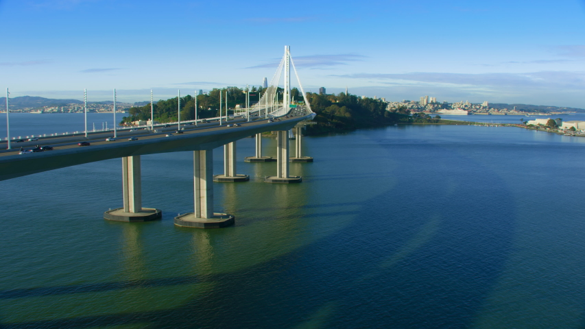 Aerial view of the San Francisco Oakland Bay Bridge during rush hour, full of traffic. Yerba buena and Treasure Island in the background. Interstate 80. California, USA. Shot on Red weapon 8K.