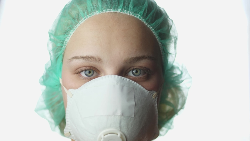 Woman Wearing a Medical Mask, Close Up | Shutterstock HD Video #1048205185