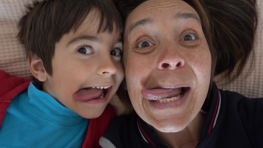 4K Selfie of Funny mother and son putting out their tongues