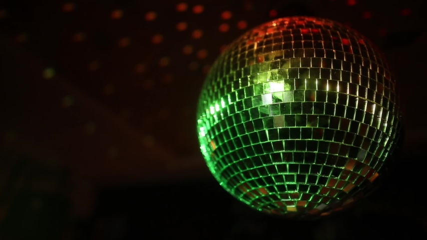 Color HD handheld footage of a spinning disco ball. | Shutterstock HD Video #1048213825