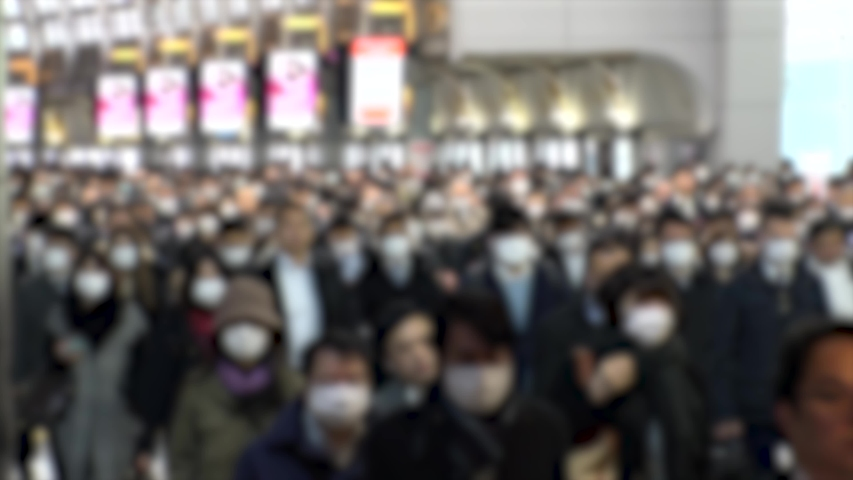 TOKYO, JAPAN - MARCH 2020 : Crowd of people walking at Shinagawa station in morning rush hour. Many commuters going to work. People wearing mask to protect from Coronavirus(COVID-19). Blurred shot. #1048216786