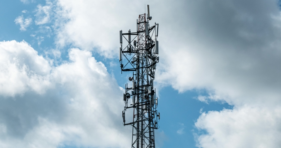 Time lapse of older Cell tower antennas transmitting data, repeaters for mobile communications and the Internet, GPS, cellphone, 3G, 4G and 5G telecommunication tower with moving clouds, storm. 4Kloo | Shutterstock HD Video #1048218073