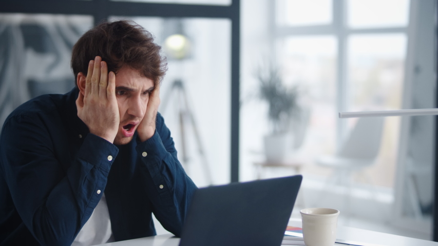 Sad businessman closing face in front of computer in slow motion. Close up upset employee getting bad results of project in office. Frustrated business man finding mistakes in documents. | Shutterstock HD Video #1048219315