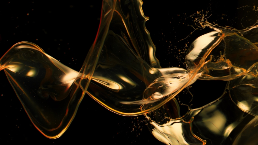 Super Slow Motion Shot of Swirling and Splashing Golden Oil Isolated on Black Background at 1000fps.