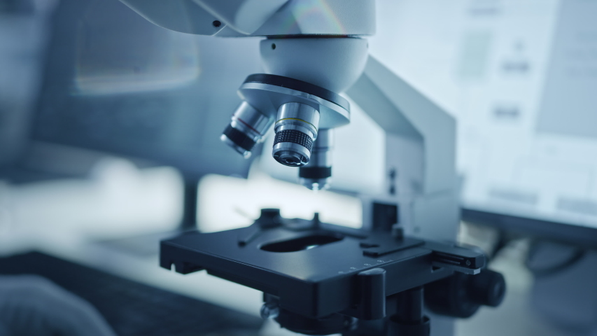 Research Factory Cleanroom: Close-up of Engineer / Scientist wearing Coverall and Gloves Use Microscope to Inspect Motherboard Microprocessor Component, Developing High Tech Modern Electronics Royalty-Free Stock Footage #1048253782