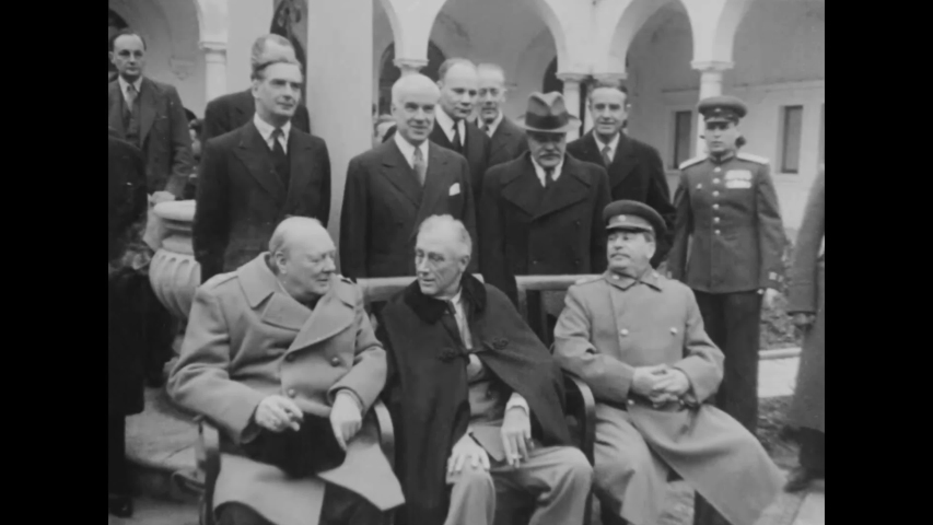 CIRCA 1945 - Joseph Stalin, FDR, and Winston Churchill pose for photographers at the Yalta Conference a famous summit held during World War Two.