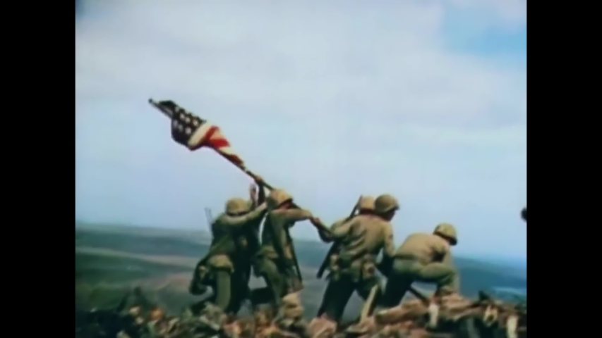 CIRCA 1945 - Iwo Jima iconic image of Marines soldiers raising the American flag in this patriotic world war two image.