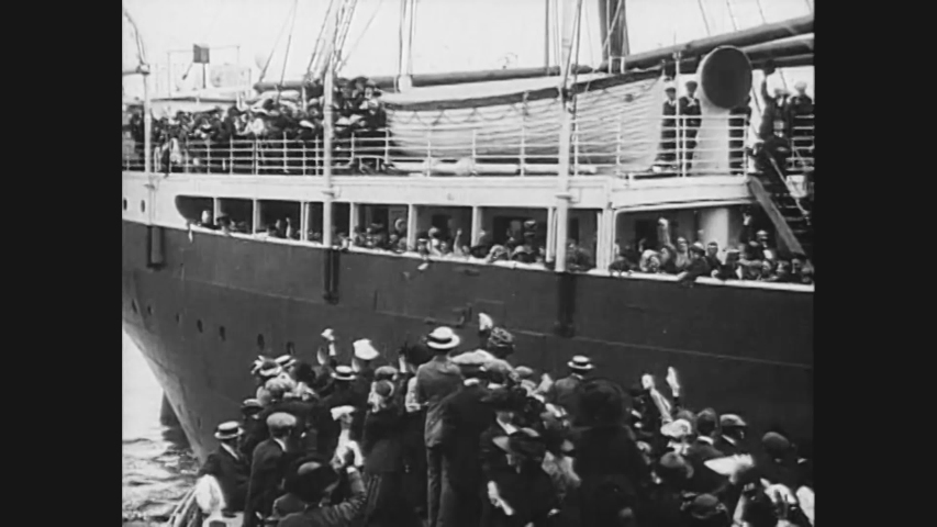 CIRCA 1912 - Massive crowds wave from the dock as the Titanic embarks on its fateful voyage.