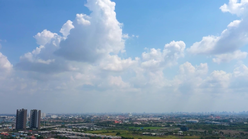 Beautiful clear blue sky with white clouds background. Time lapse clouds 4k rolling puffy cloud movie. high beautiful cloud space weather beautiful blue sky glow clouds background. Royalty-Free Stock Footage #1048289647