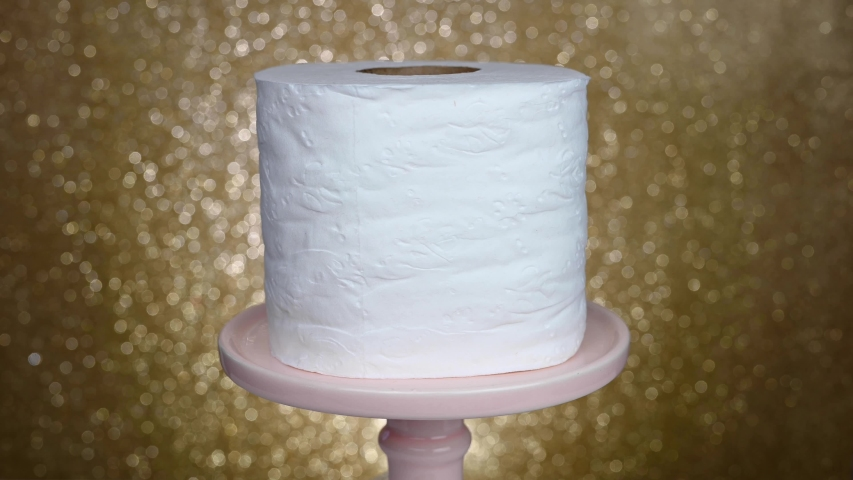 Spinning roll of toilet paper on gold background - coronavirus covid shortage concept | Shutterstock HD Video #1048308796