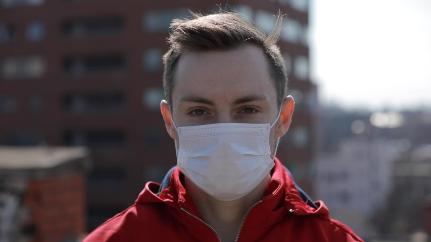Virus epidemic, man wearing face medical mask on the roof under city | Shutterstock HD Video #1048310704