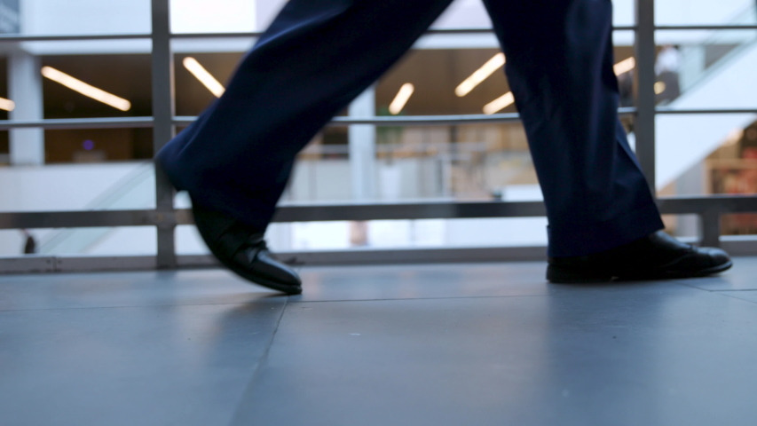 Office Managers and Business People Going to Work Closeup. Businesspersons Legs in Black Shoes Walking to Office. Urban Business Lifestyle Background. Pedestrians Anonymous Persons Walking in City. Royalty-Free Stock Footage #1048397281