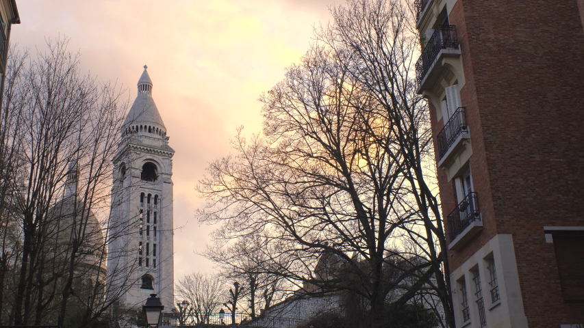 Sacre Coeur Basilica Famous landmark in Paris Montmartre district at Sunset 4K B-Roll establishing shot