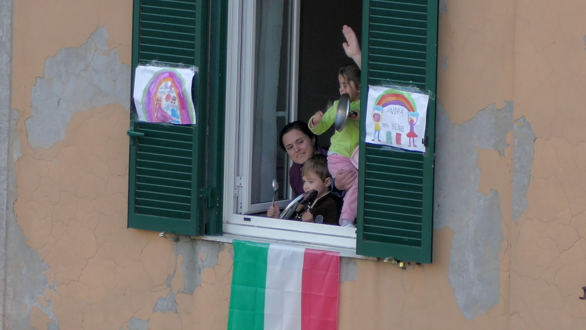 ROME, ITALY - MARCH 15, 2019: National italian flash mob in Rome, citizens staying on balconies with flags and singing anthem, uniting in epidemic period of deadly coronavirus. People in quarantine