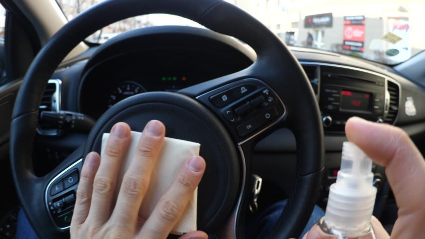 Man Cleaning Steering Wheel By Spraying With Disinfectant, Disinfection And Sanitizing.  Royalty-Free Stock Footage #1048434982