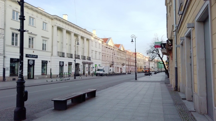 Warsaw, Poland, 03.16.2020 - Apocalyptic scenery of the empty Nowy Swiat Street in Warsaw, declared State of Epidemic threat. Only the fire truck on the main historic thoroughfares of Warsaw