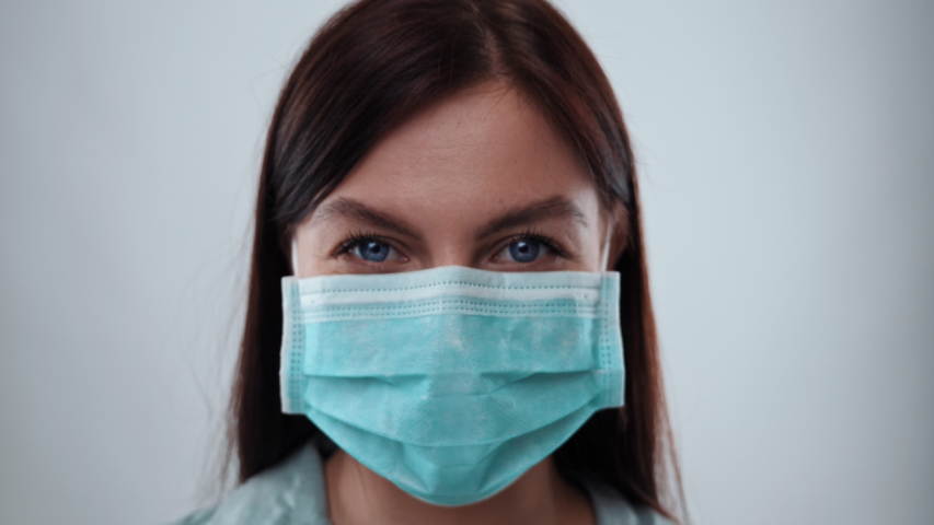 Girl Puts on Medical Mask Portrait. Health Protection Corona Virus Concept | Shutterstock HD Video #1048443949