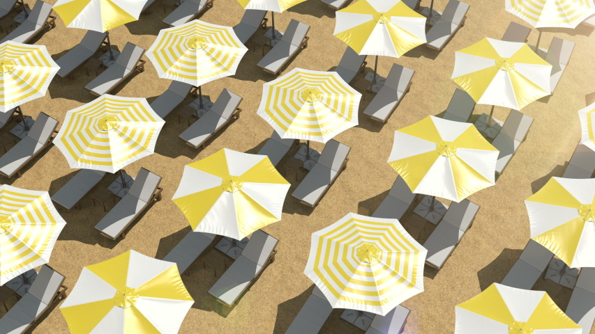 Aerial view on the empty beach with many chaise lounges and colorful umbrellas. Scene without any people on the sandy beach. Yellow parasols and wooden sunbeds set up on the ocean coast in the rows. | Shutterstock HD Video #1048447882