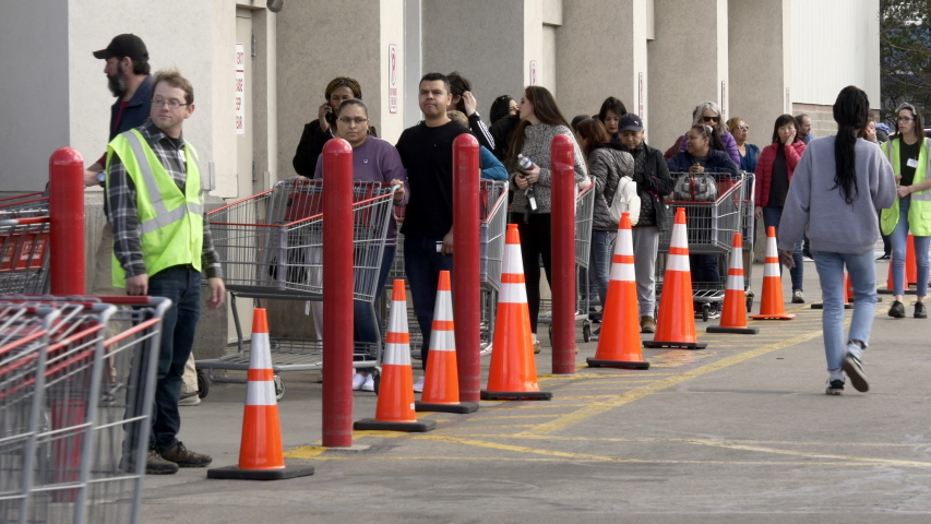 Salt Lake City, Utah, U.S.A, March 2020.  People standing in long lines waiting to enter Costco Wholesale to shop because of the COVID-19, or Coronavirus pandemic.