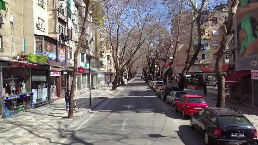 TIRANA, ALBANIA - MARCH 14, 2020: Aerial footage of Myslym Shyri str, one of the busiest streets in Tirana  amid COVID-19 crisis, totally empty FHD/40Mbps