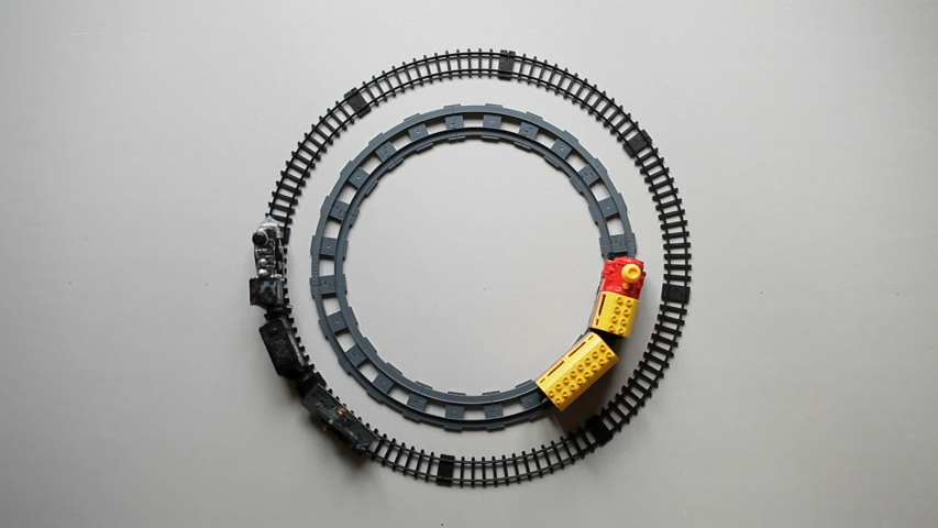 Childish toy railway. Two toy trains travel along the ring railway. Top view.