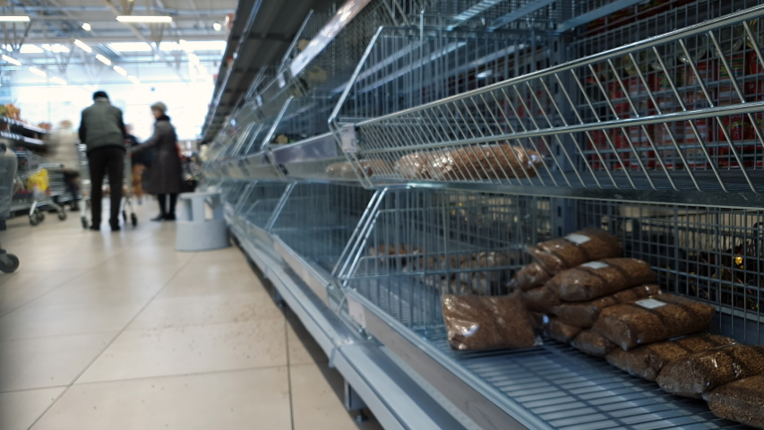 Empty shelves in a super market. People are buying a lot of food. Quarantine Coronavirus Panic from the Chinese Covid19 virus corona. Timelapse. | Shutterstock HD Video #1048515859