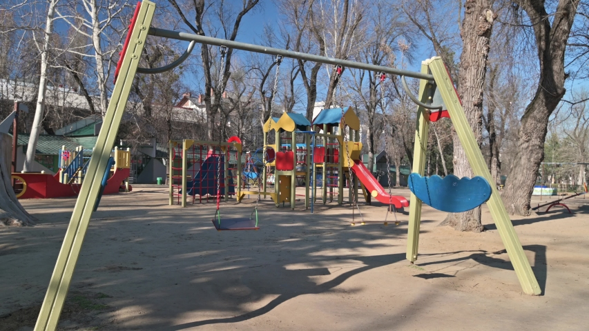 Chisinau, Moldova - March 17, 2020: Empty children playground in cathedral square park in the center of city during quarantine by reason of coronavirus AKA covid-19 virus threat. State of emergency