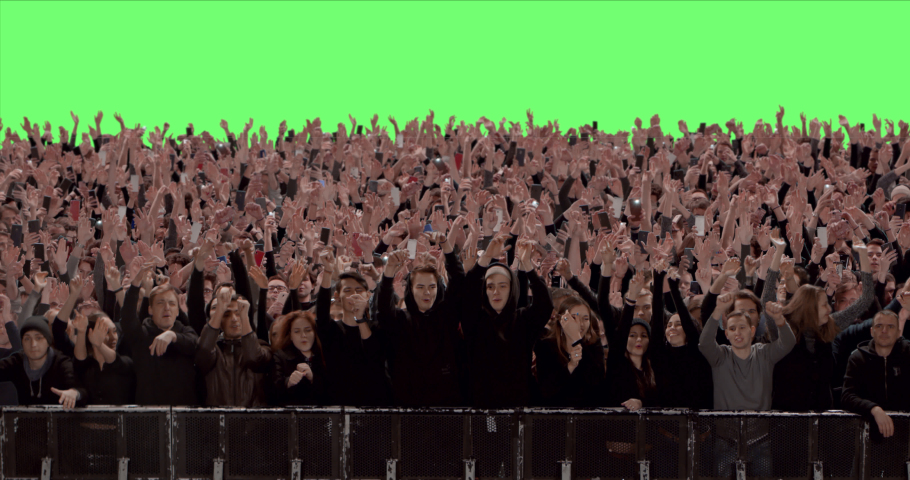 GREEN SCREEN CHROMA KEY Model released, Front view of huge crowd dancing and cheering at a concert or a show behind control barrier. Shot on RED Helium 8K Prores 4444