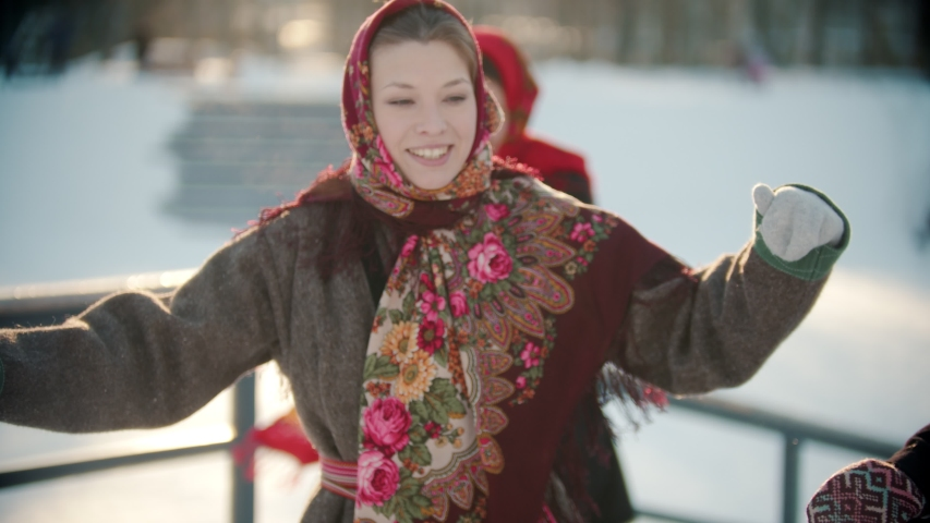 Russian folklore - a woman in a bright shawl is dancing Russian folk dance Royalty-Free Stock Footage #1048525816