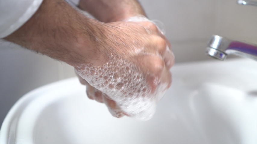 Person Rinsing Hands in Bathroom at Home. Washing Hands the way Coronavirus Rinse Water Rub Soap Dry Towel Covid. | Shutterstock HD Video #1048544476