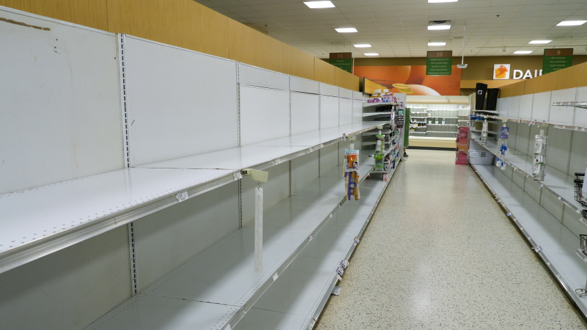 Miami, USA - March 17, 2020: Empty shelves at grocery store. Sold out goods due to covid-19 coronavirus disease.